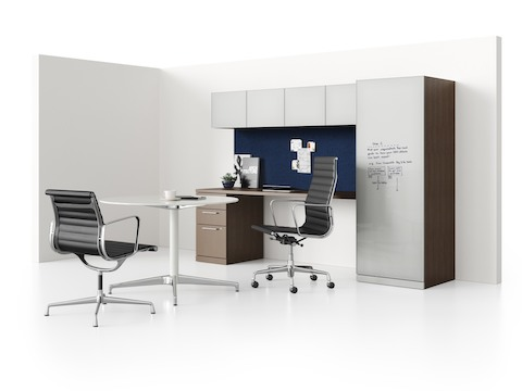 Sketches on a writable tower door in a Canvas Private Office that also includes overhead and pedestal storage.