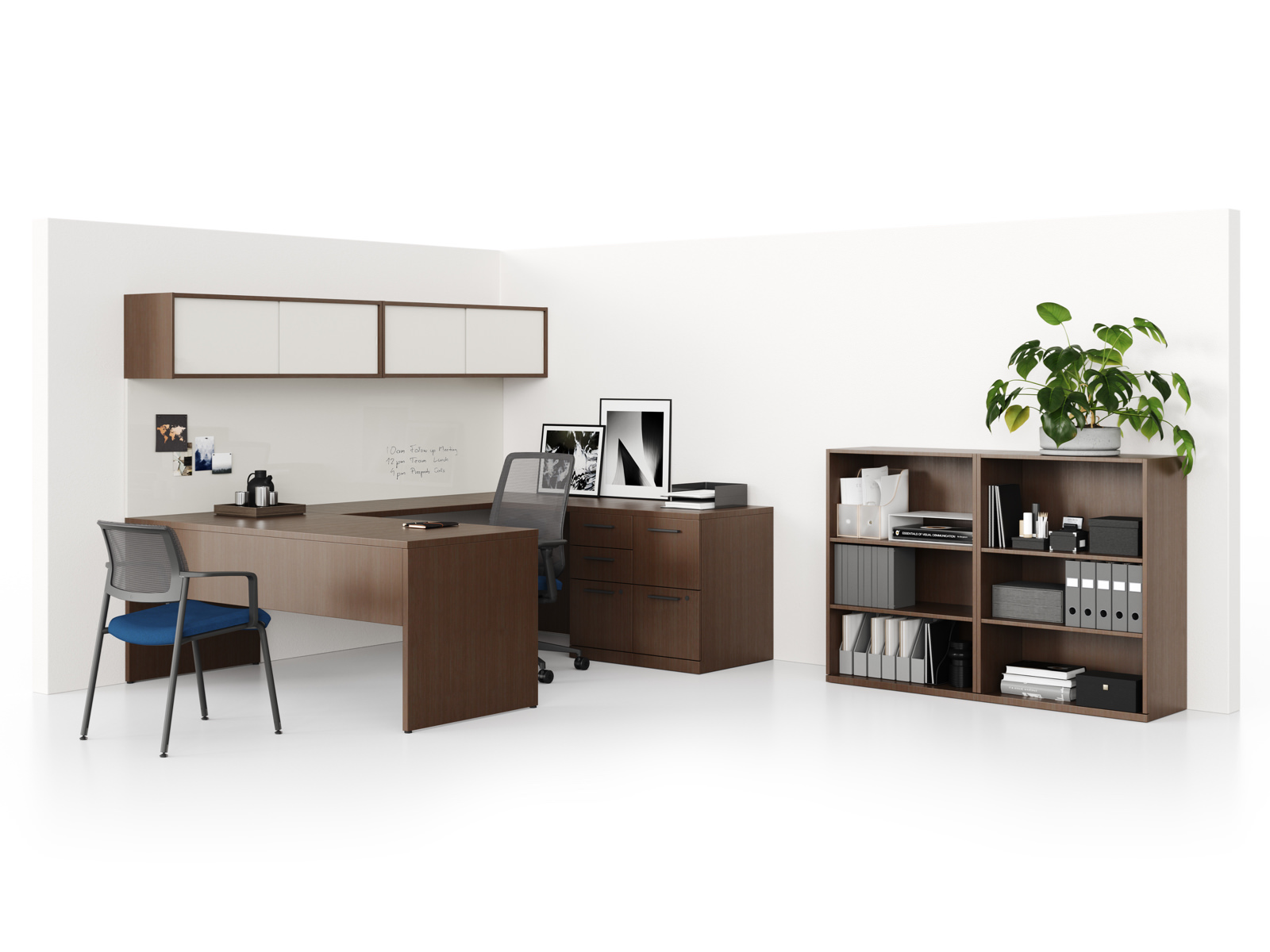 A Canvas Private Office with a U-shaped workstation and freestanding bookcase in a dark wood finish, supported by Verus office and side chairs.