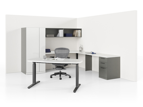 An Aeron office chair sits between a Renew Sit-to-Stand Table in the foreground and an L-shaped Canvas Private Office configuration along the back walls.
