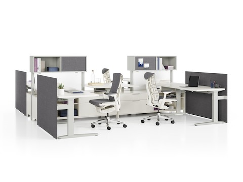 Canvas Dock workstations with sit-to-stand tables, storage, grey screens, and grey Embody Chairs.