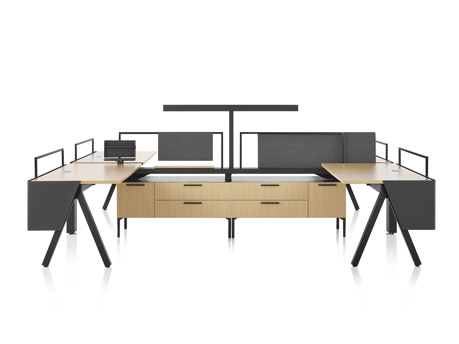 Brown and black Canvas Vista workstations with a-shaped legs, modesty screens and t-shaped light.