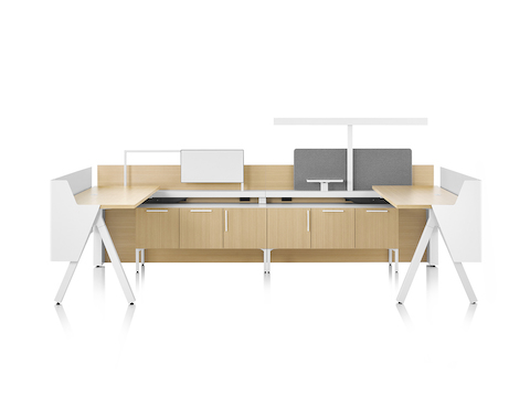 Brown and white Canvas Vista workstations with a-shaped legs, modesty and privacy screens, t-shaped light and gray boundary screens.