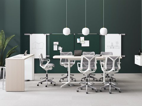 A rendering of Headway communal and Y Base table in a work room with Cosm Stools, Logic Reach providing power, and Exclave Collaborative Furniture.