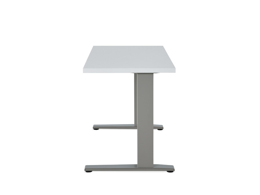 A photo - Motia Sit-to-Stand Table–Rectangular–C Foot