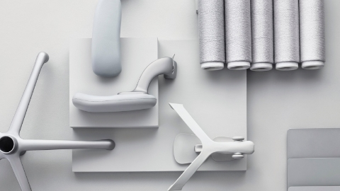 An overhead view of an array of light gray Aeron ergonomic desk chair components.