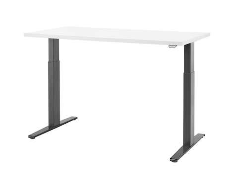 A Motia standing desk with dark gray legs and white work surface raised to standing height.
