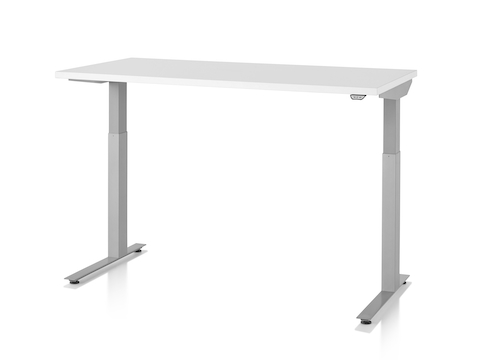 A Nevi standing desk with light gray legs and white work surface raised to standing height.