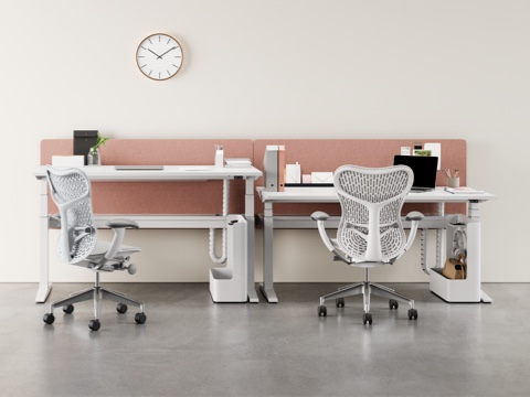 A Locale collaboration space featuring height-adjustable surfaces, a small table, a low workbase, beige privacy screens, and Setu and Aeron office chairs.