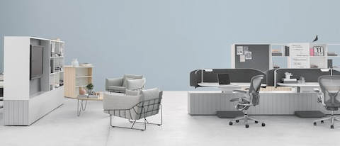 Locale elements divide space in a collaboration area that includes light grey Aeron office chairs and Wireframe lounge chairs.