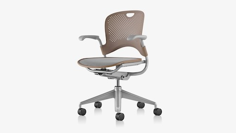 A light brown Caper Multipurpose Chair with a grey seat, viewed from an angle and showing contoured seat and back.