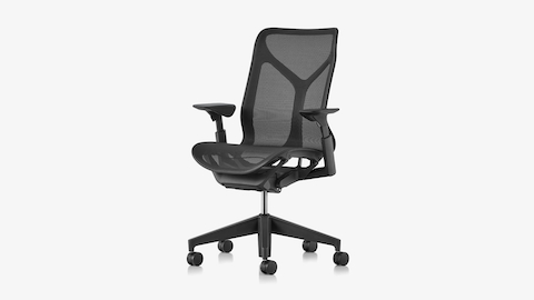 A Graphite dark grey Cosm mid-back desk chair with adjustable arms, viewed from an angle.