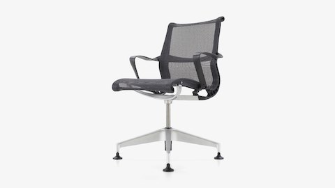 A Setu desk chair with charcoal frame and mesh upholstery and aluminum base with floor glides, viewed from an angle.