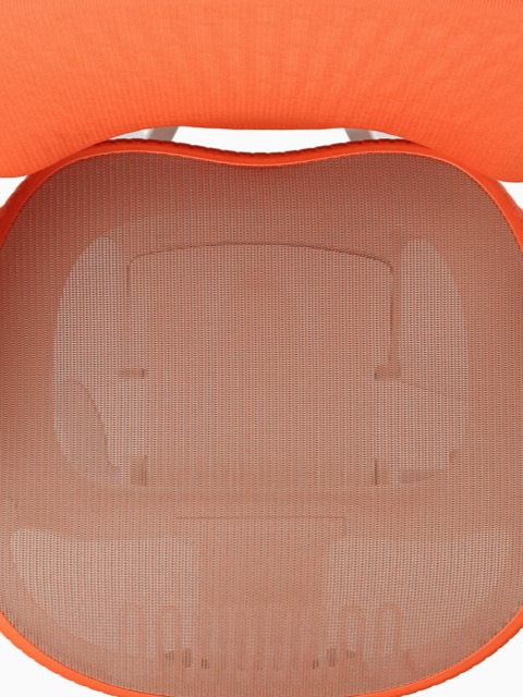 An overhead view of a Mirra 2 ergonomic desk chair with orange mesh, white frame, and light gray armpads.
