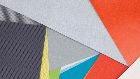Layers of multi-colored fabric and material swatches showing the various textures, finishes and materials available.