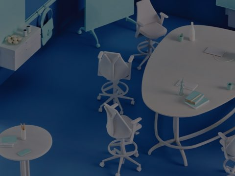 A model of a blue office collaborative space with a miniature white Exclave work table surrounded by miniature white Sayl stools.