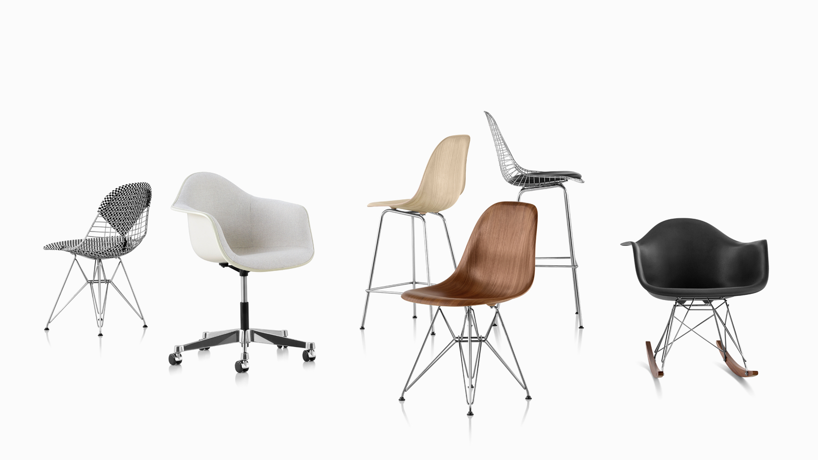 A casual arrangement of Eames shell chairs and stools in fiberglass, wire, wood, and plastic.