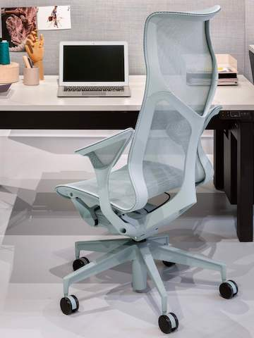 A close-up image of a Glacier High-Back Cosm Chair at a Canvas Vista office desk.