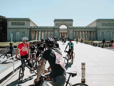 Bicyclists gather near the Legion of Honor Arch in San Francisco.