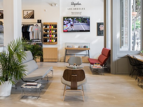 Custom Herman Miller furniture, including two Eames Sofa Compacts, in Rapha's retail location in Los Angeles.