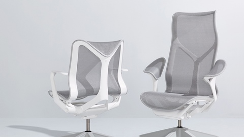 A low-back Cosm Chair, viewed from behind, and a high-back Cosm Chair, viewed from the front; both with gray suspensions and white frames.