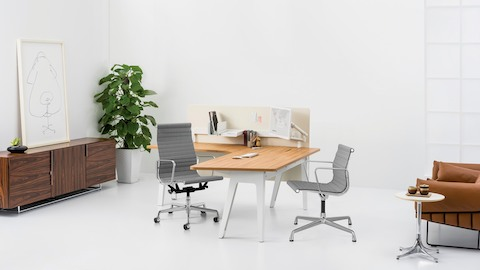 A contemporary private office featuring an L-shaped Optimis desk. Select to go to the Optimis Desking System product page.