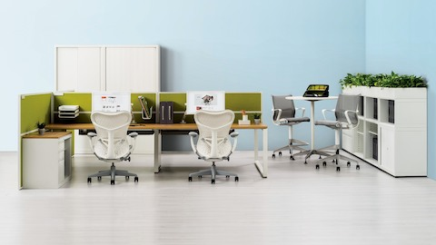 Two benching workstations featuring Imagine desks and white Mirra 2 office chairs. Select to go to the Imagine Desking System product page.