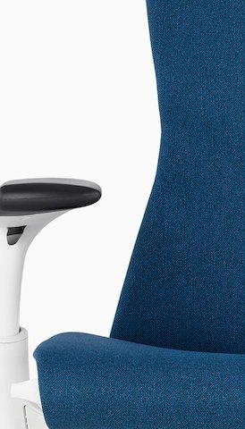 Close-up of the back and arm of a blue Embody office chair. Select to go to the Seating product page.
