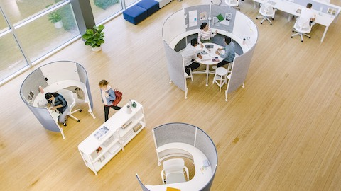 Overhead view of an open office featuring Prospect collaborative and solo workspaces. Select to go to the Prospect product page.