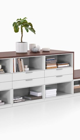 A storage unit with drawers and shelves. Select to go to the Herman Miller Storage product page.