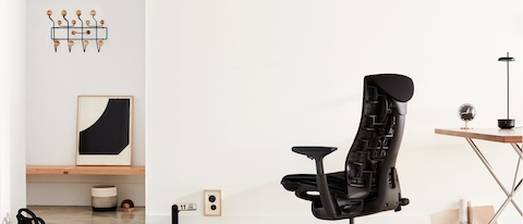 A black Embody office chair, viewed from the back at an angle.