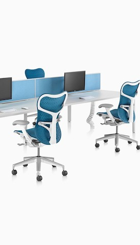 A back-to-back benching setup using white Layout Studio work surfaces and blue Mirra 2 Chairs. Select to go to the Desks and Workspaces product page.