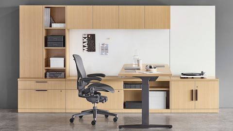 A Canvas private office configuration with a black Aeron office chair. Select to go to Canvas Private Office.