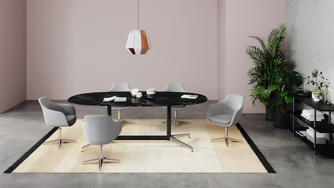 A black marble Civic table with five grey Saiba Chairs.