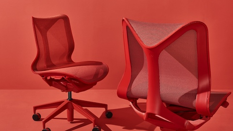 Two armless, low-back Cosm Chairs in Canyon red. Select to go to the Cosm Chairs product page.