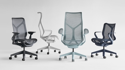 A grouping of Graphite gray, Mineral gray, Nightfall navy blue, and Glacier light blue Cosm Chairs. Select to go to the Cosm Chairs product page.