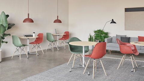 Terra Cotta and Dark Seafoam Fiberglass Chairs with Eames 30-inch Conference Tables. Select to go to the Eames Molded Fiberglass Chairs product page.