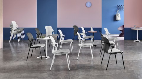 Black and white Keyn stackable side chairs in a training environment. Select to go to the Keyn Chairs product page.