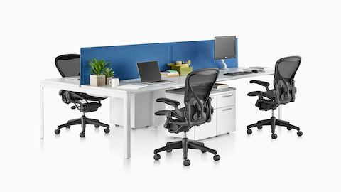 A benching setup featuring Layout Studio and Aeron office chairs. Select to go to the Layout Studio product page.