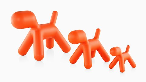 Three sizes of an orange Magis Puppy, a sculptural plastic form shaped like an abstract dog. Select to go to the Magis Puppy product page.