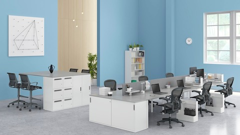 An open, collaborative workplace supported by Paragraph Storage elements and black Aeron office chairs. Select to go to the Paragraph Storage product page.