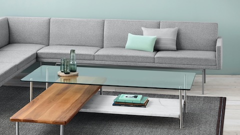 Noble heathered grey Tuxedo Sofa with a Layer table