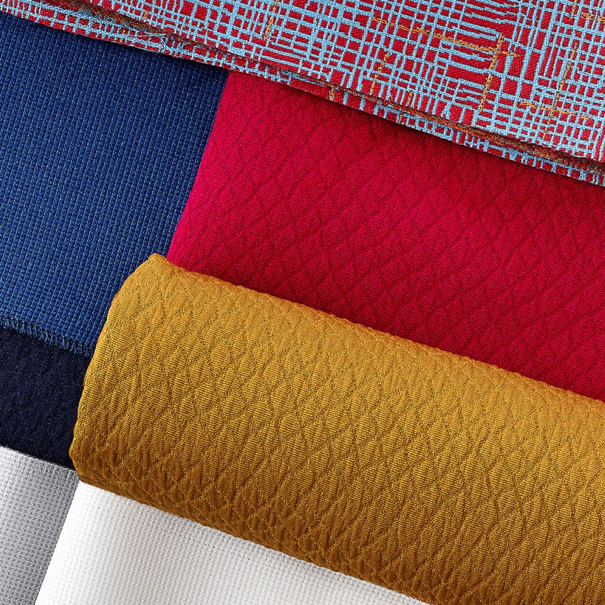 An overhead view of a variety of material samples in a range of colors.