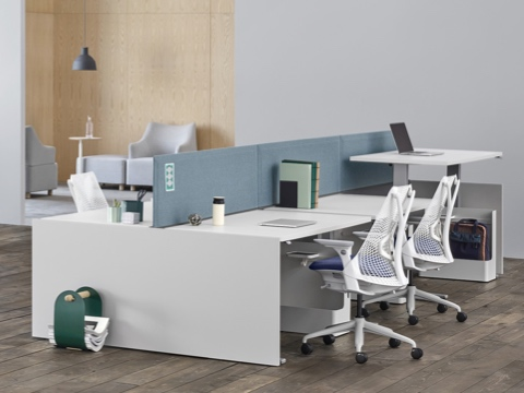 Canvas Channel And Canvas Dock Workstations With Blue Fabric Screens And  White Desks Near A Lounge