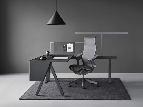 A Canvas Vista workstation in black and gray with a dark gray Cosm office chair.