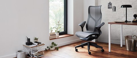 A high back Cosm Chair in a modern home office.