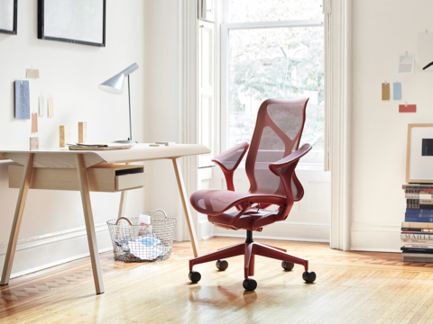 Cosm Chair in Canyon at a Distil Desk in a brightly lit home office.