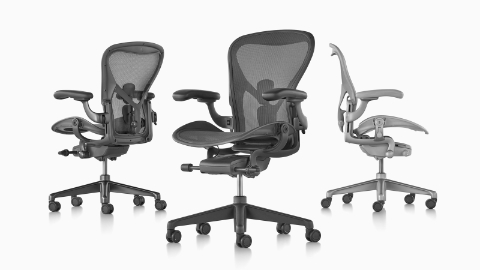 Three Aeron office chairs viewed from different angles.
