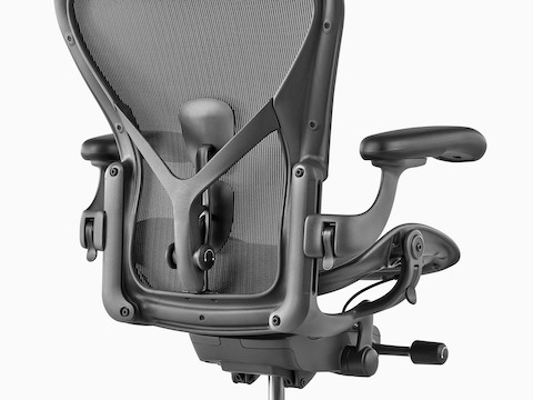 A black Aeron office chair, viewed from the rear and showing the back support.