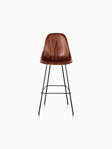 An Eames Molded Wood Stool with a dark finish and black legs, viewed from the front.