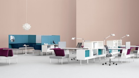 An open office featuring Public Office Landscape workstations and collaboration areas in shades of grey, magenta, and blue.